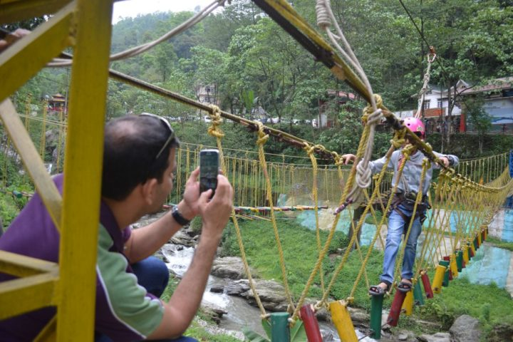 Dad excited seeing his sone complete rope challenge course in Sikkim