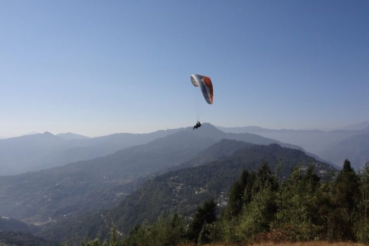 Enjoy the view from Captain seat while paragliding in Sikkim