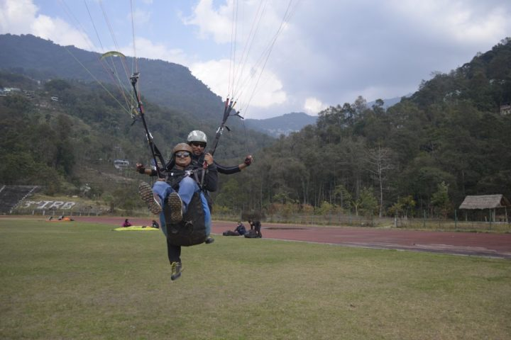 Final touchdown during paragliding flight in Sikkim
