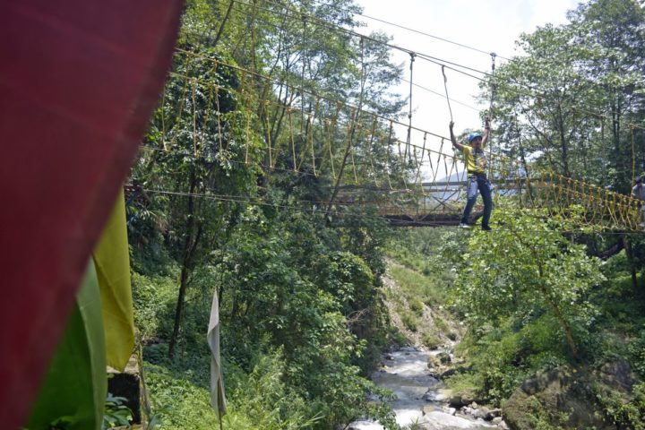 River crossing on mougli walk rope challenge course in Gangtok