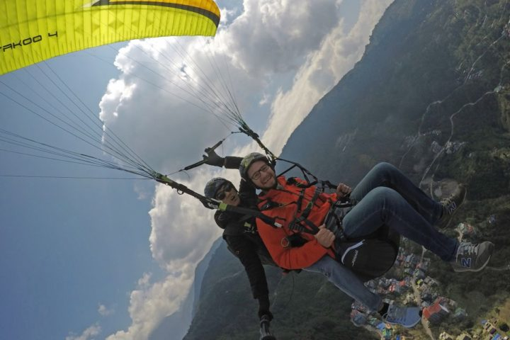 Share your smile with the world when paragliding in Gangtok
