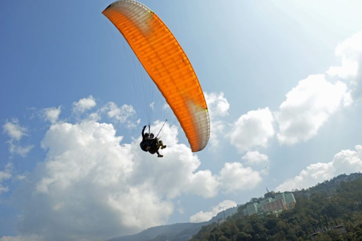 Soar high and the world will be at your feet when paragliding in gangtok,Sikkim
