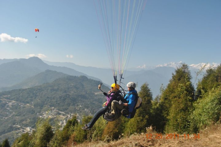 Takeoff during Mountain View paragliding flight in Gangtok